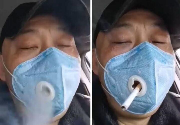 курит в защитной маске